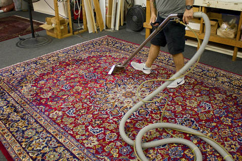 Using our hot wash on a rug. This cleans area and oriental rugs while still maintaining their integrity.