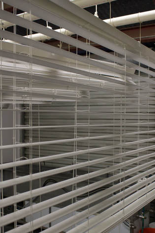 Blinds hanging at our facility to dry after cleaning. We clean blinds right!